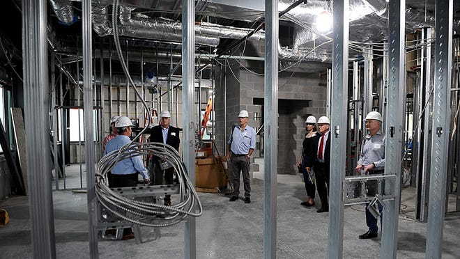 International scientists toured ABI-LAB in Natick last September to show prospective investors that MetroWest is the place to expand their life sciences businesses. A 68,000-square-foot ABI-LAB building was under construction at the time.