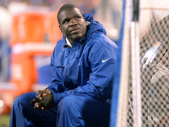 Indianapolis Colts running back Frank Gore watches