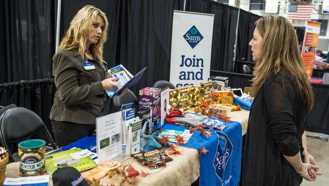 Christina Thomas with Sam's Club speaks to Wendy Zakarias during the Business Expo held at the Kellogg Arena on Wednesday.
