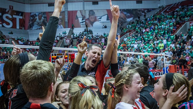 Wapahani's celebrates a State Championship win against Speedway at Worthen Arena Saturday, Nov. 7, 2015.