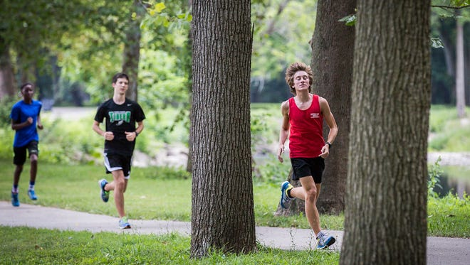 Kevin Kratz runs at Morrows Meadow during Yorktown's cross country practice Thursday.
