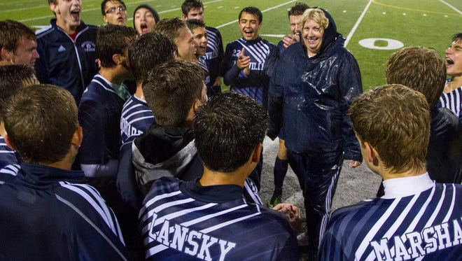 The Marysville Vikings celebrate after their 2-1 win against St. Clair Oct. 11. The Vikings' win sealed the state championship title.
