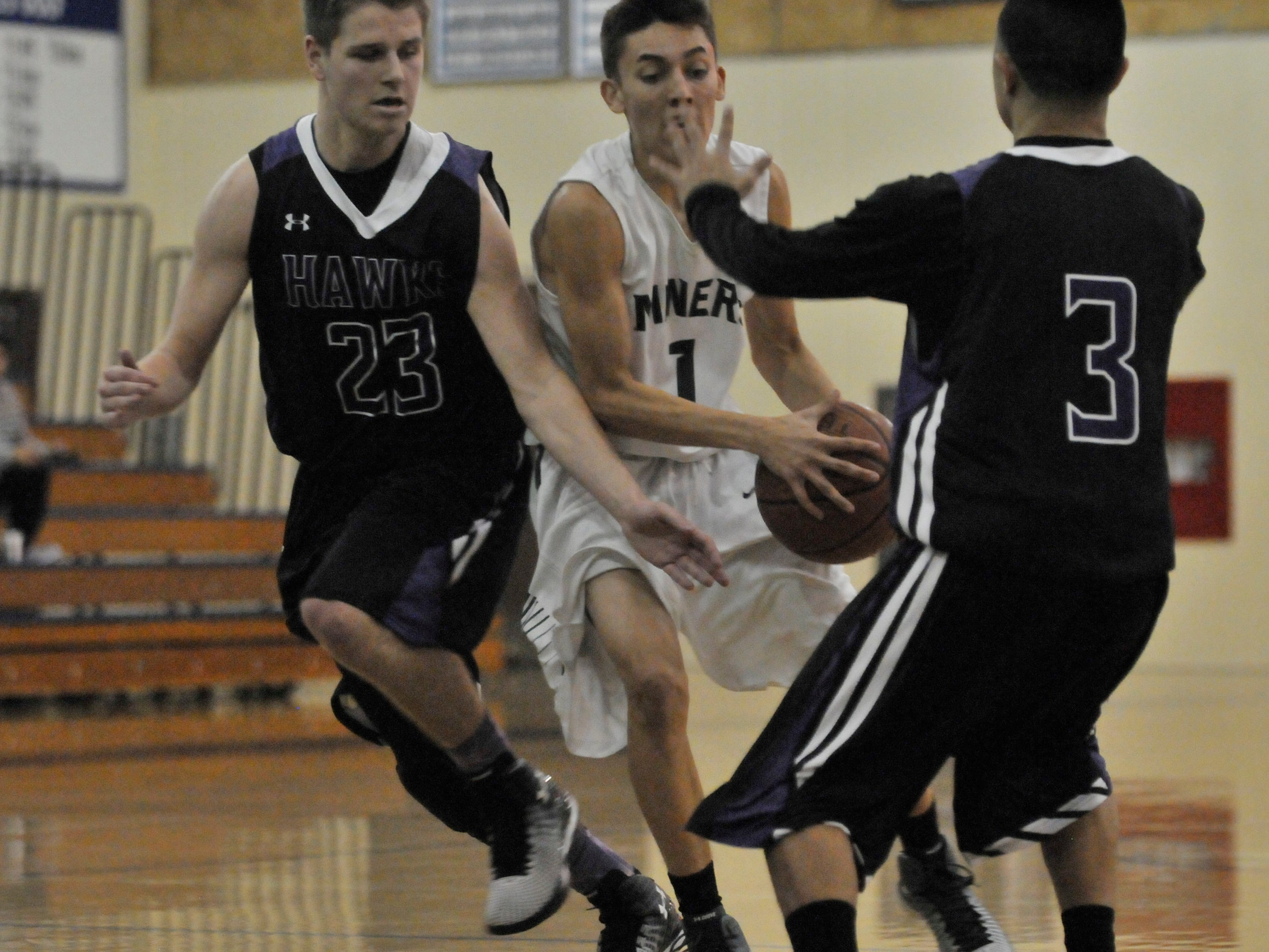 El Diamante's Isaiah Villareal is defended by Mission Oak's Will Shannon (23) and Josh Garcia (3) during a Polly Wilhelmsen Invitational game in December. The Hawks and Miners could meet in Friday's Division II quarterfinals.