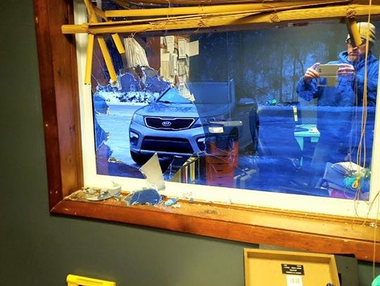 A window was smashed and a lock box with cash inside