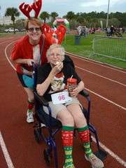 Doris Pritchard, 91, veteran of six NYC marathons, gets an assist from daughter Karen Attanasio.
