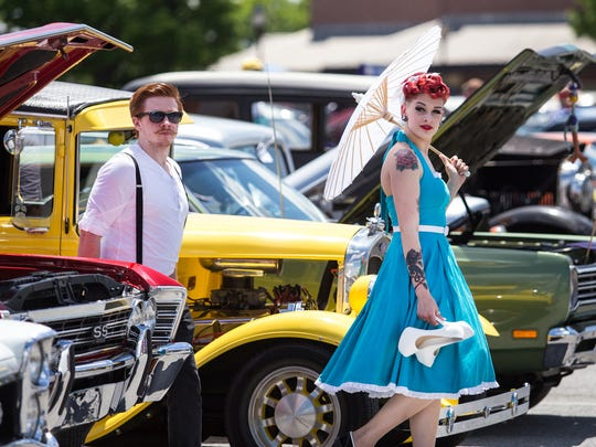 Mike Callahan and Allison McGuire walk through classic cars at the Wilmo a Go-Go car show in 2014. The event enters its eighth year this weekend.