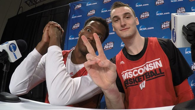 Wisconsin's Nigel Hayes and Sam Dekker have some fun during the first half of the NCAA Final Four college basketball tournament championship game Sunday, April 5, 2015, in Indianapolis.