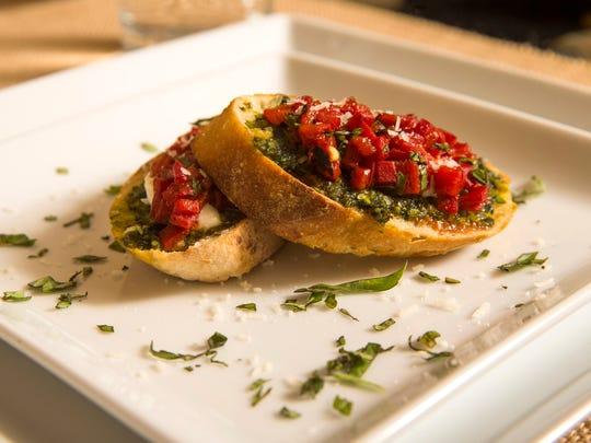 Bruschetta with homemade pistachio pesto, roasted red pepper jam and fresh mozzarella by Top Home Chef finalist Lynn Hooker, Wednesday, September 28, 2016.