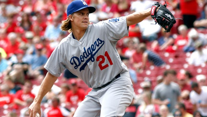 Dodgers starting pitcher Zack Greinke throws against the Cincinnati Reds in the second inning  Thursday at Great American Ball Park.