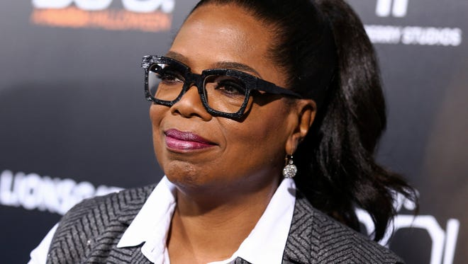 "FILE - In this Oct. 17, 2016 file photo, Oprah Winfrey attends the world premiere of ""BOO! A Madea Halloween"" in Los Angeles. Weight Watchers stock is gaining Thursday, Dec. 22, after another weight loss announcement by Winfrey. The former talk show host, who owns a stake in Weight Watchers, said in a new ad that she lost more than 40 pounds on the plan while still being able to eat pasta and tacos. (Photo by John Salangsang/Invision/AP, File)"