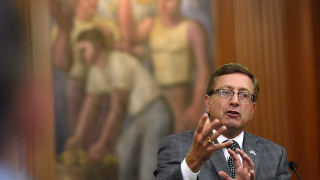 Jay Pickthorn / Argus Leader Sioux Falls Mayor Mike Huether affirmed his plans to move forward with financing for a planned city administrative building after a court earlier this week gave the all-clear. Sioux Falls mayor Mike Huether discusses his decision to veto the City Administration building Ordinance repeal during a press conference on Wednesday at City Hall.