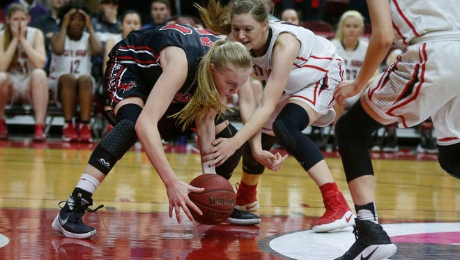 Cedar Falls junior Cynthia Wolf scoops up a loose ball to help secure the win over Iowa City High during the Iowa high school girls state basketball tournament on Wednesday, March 1, 2017, at Wells Fargo Arena in Des Moines.
