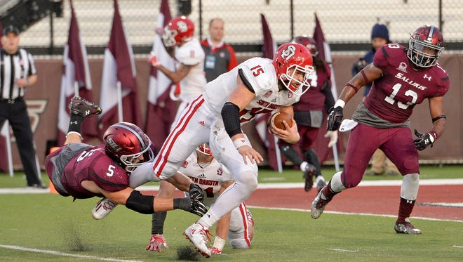USD quarterback Chris Streveler is taken down by Southern Illinois' Chase Allen.