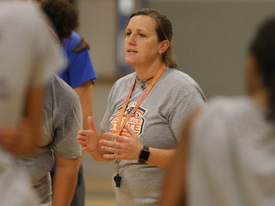 Blackman girls basketball coach Jessica Jackson talks to her team after practice Monday night on the first day of practice.