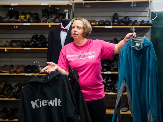 Karen Buschkill, a Hangers employee, asks a student