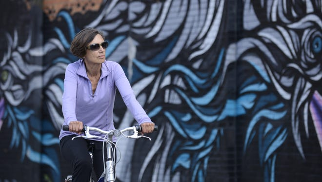 """Maria Urquidi rarely uses her car, preferring to ride her bike everywhere. She says she """"retired to Detroit"""" from her job as a digital technology specialist for a school system in the Hudson River Valley of New York."""