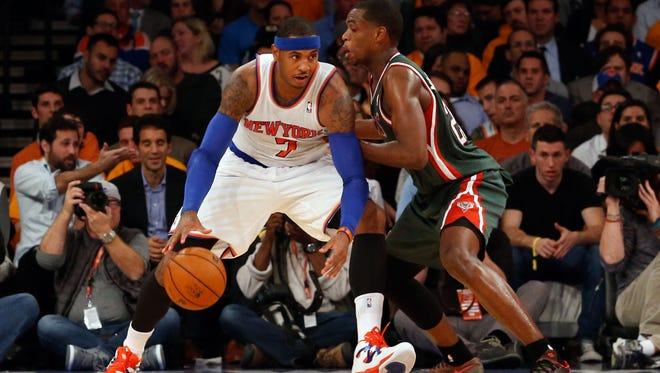 Knicks small forward Carmelo Anthony (7) drives the ball past Milwaukee Bucks small forward Khris Middleton (22) during the second quarter at Madison Square Garden.