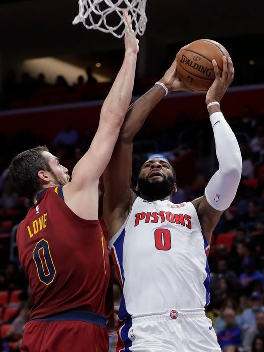 Detroit Pistons center Andre Drummond (0) shoots as Cleveland Cavaliers forward Kevin Love (0) defends during the first half of an NBA basketball game, Monday, Nov. 20, 2017, in Detroit. (AP Photo/Carlos Osorio)