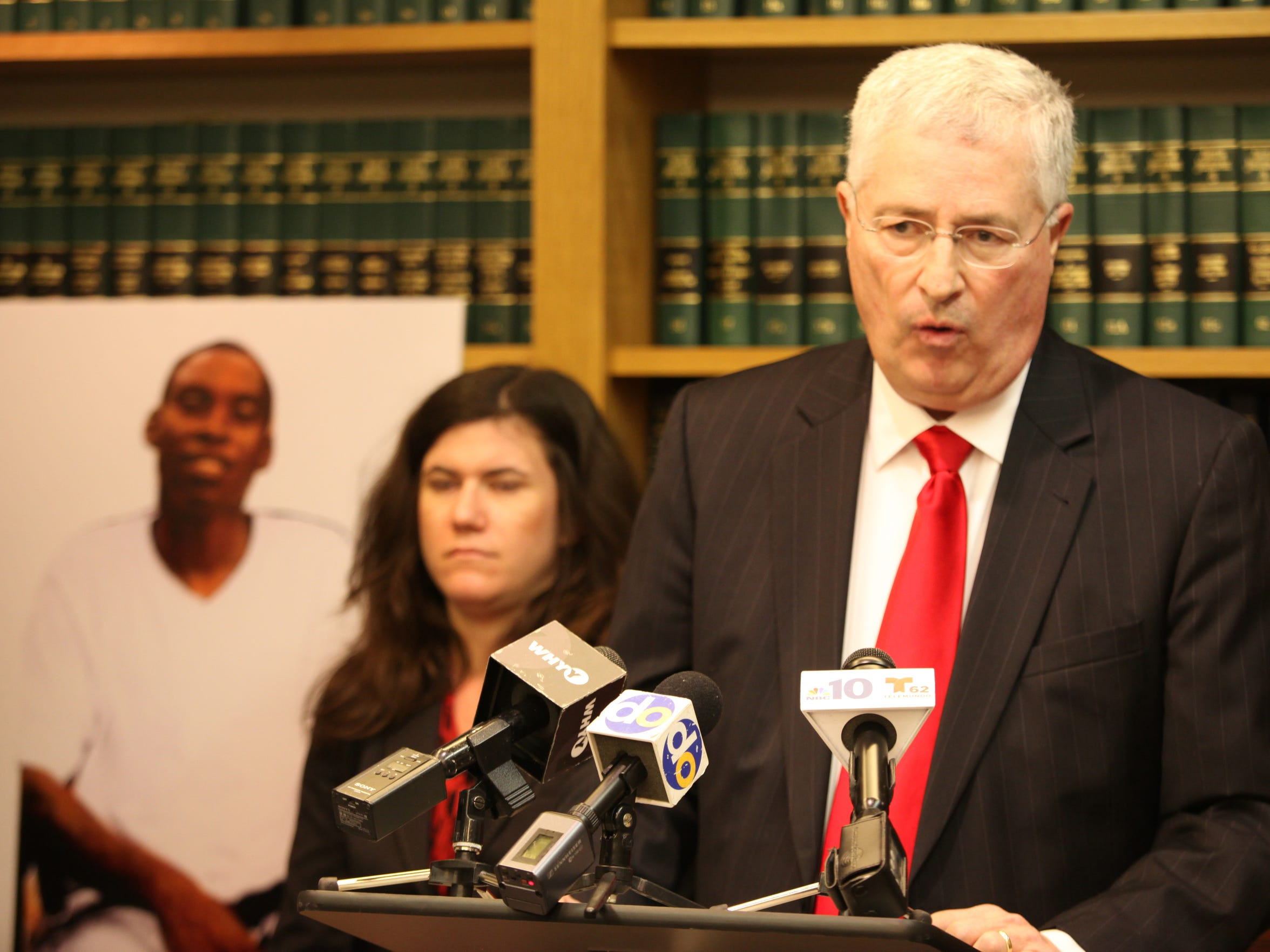 "Attorney Thomas Neuberger (right) during a press conference Thursday in Wilmington where a lawsuit was announced for ""the tragic and unnecessary death of Jeremy"" McDole seen in photograph."