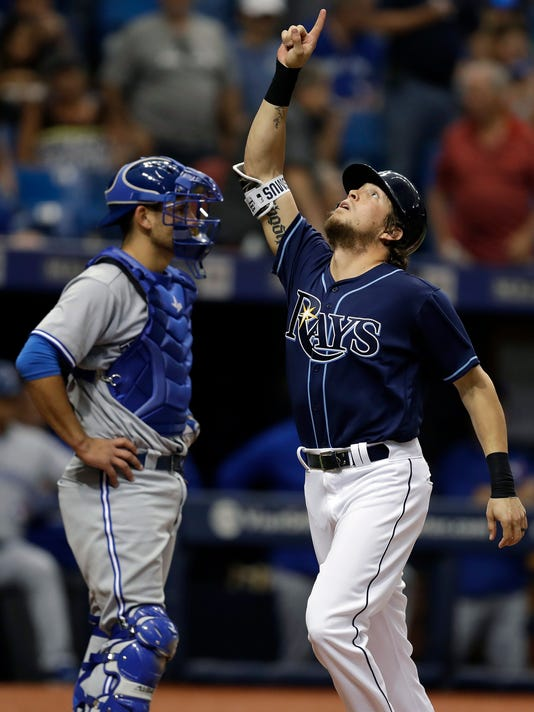 Tampa Bay Rays' Colby Rasmus, right, celebrates in front of Toronto Blue Jays catcher Luke Maile after hittinga two-run home run off Marco Estrada during the sixth inning of a baseball game Saturday, May 6, 2017, in St. Petersburg, Fla. (AP Photo/Chris O'Meara)