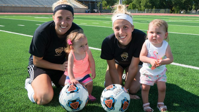 UW-Oshkosh Women's Soccer Team Captains Rachel Elliott and Robyn Elliot with Chloe Roehling and Kendall Roehling.