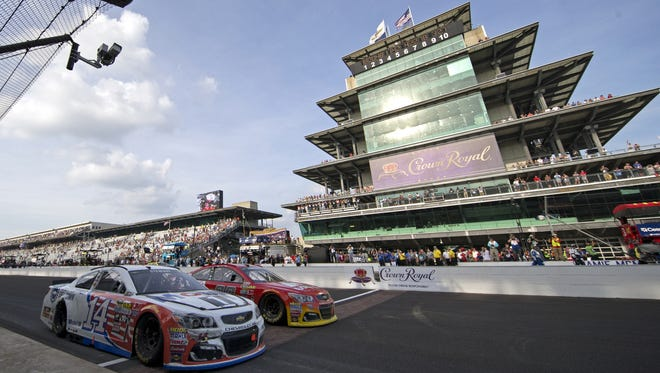 Tony Stewart and Jeff Gordon take a lap together at the end of the 23rd annual Brickyard 400 at Indianapolis Motor Speedway, Sunday, July 24, 2016.