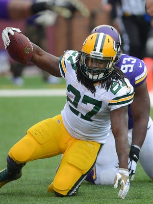 Green Bay Packers running back Eddie Lacy (27) celebrates a touchdown against the Minnesota Vikings at TCF Bank Stadium November 23, 2014.