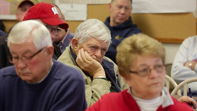 People listen to information on proposed cuts to the Central States Pension Fund on Dec. 4 at Town of Schleswig Hall near Kiel.