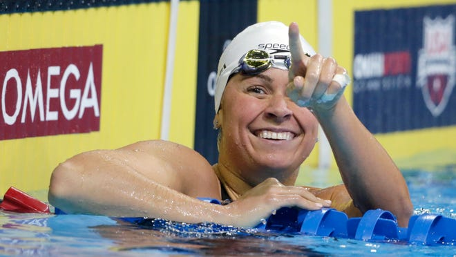 Elizabeth Beisel reacts after her heat in the women's 200-meter backstroke preliminaries at the U.S. Olympic swimming trials, in Omaha, Neb., Friday, July 1, 2016. (AP Photo/Nati Harnik)