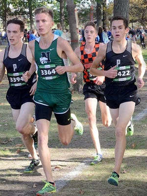 Running at the front of the KLAA cross country meet are (left to right) Plymouth's Ethan Byrnes, Novi's Gabriel Mudel, Brighton's Jack Spamer and Plymouth's Carter Solomon. Mudel won in 15:33.1.