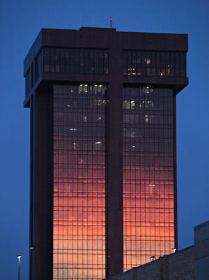 The sunset is reflected on the side of Hammons Tower.