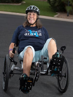 Mary Fuchs has Ataxia and uses a catrike to get around.