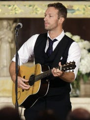Chris Martin of Coldplay performs during the funeral