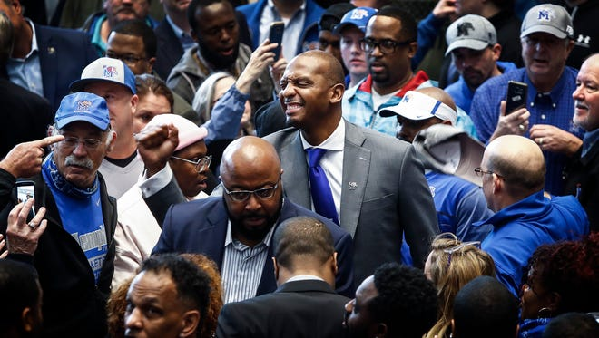 """Former Tigers great Anfernee """"Penny"""" Hardaway (middle) greets fans after being introduced as the new Memphis men's basketball coach on Tuesday."""