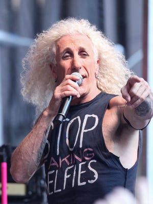 """Dee Snider of Twisted Sister performs during """"FOX & Friends"""" All American Concert Series outside of FOX Studios on July 25, 2014 in New York City. Snider will be a guest at the Fanboy Expo Totally Awesome Weekend show in Knoxville from Oct. 6-8."""