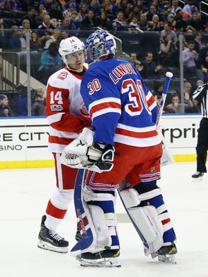 Red Wings forward Gustav Nyquist chats with Rangers goalie Henrik Lundqvist following a save during the first period on Friday, Nov. 24, 2017, in New York.