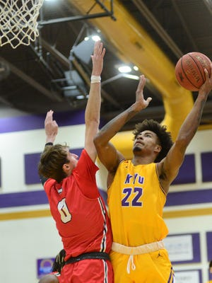 Kansas Wesleyan's CJ Weathers (22)  puts up a shot over McPherson's Gage Maccoy (0) during the first half Wednesday in Mabee Arena.