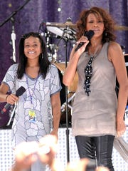 "Singer Whitney Houston, right, sings with her daughter Bobbi Kristina Brown during a performance on ""Good Morning America"" in Central Park in New York."