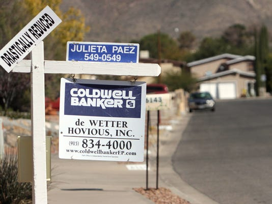 "A home for sale has a sign reading ""Drastically Reduced"" in west El Paso Thursday. Mark Lambie/El Paso Times"