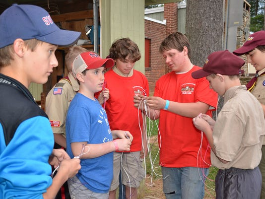In this photo submitted by Rosa Diaz, lead counselor Samuel Albright Jr teaches scouts how to braid during Shrewsbury Troop 90â  s Ninth Annual Merit Badge Camporee. Leatherwork has always been a popular merit badge among scouts of all ages. In order to accommodate all the scouts taking this merit badge,  three different sessions were held at the camporee. Submitted