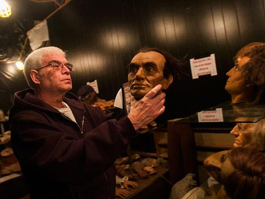 Steve Bessette, who lives in Gettysburg and collects Civil War memorabilia, studies the head of an Abraham Lincoln figurine at the Civil War Wax Museum on Steinwehr Avenue in Gettysburg.
