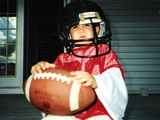 Davis grew up loving sports in Lansing. He ended up