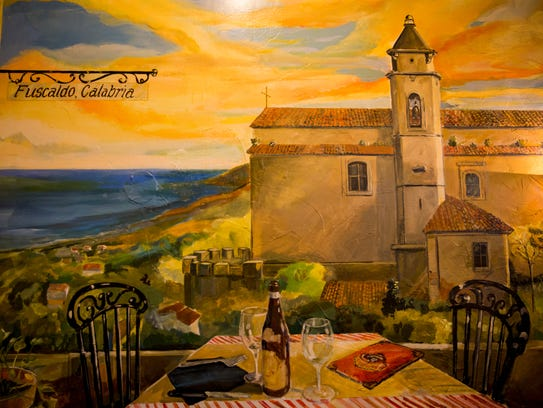 A mural of Fuscaldo, Calabria is painted inside Pompilio's