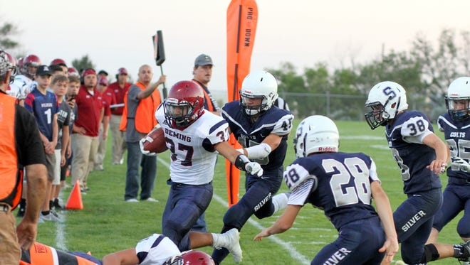 Junior running back Trini Garcia II (37) drew a herd of Colts during a Wildcat victory at Silver High back on Sept. 1.