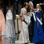 Miss Universe 2012 Olivia Culpo, from the United States, right, places the crown on Miss Venezuela Gabriela Isler during the 2013 Miss Universe pageant in Moscow.