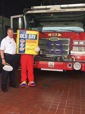 The Old Bay Can Man stopped by two Baltimore firehouses on the first day of summer.