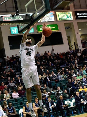 Binghamton University's Willie Rodriguez slam-dunks the ball during a game against the University of Maine in the Events Center in January.