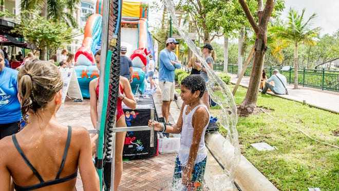 Pictured, some kids enjoy the water sports! There was a water slide, games, face painting, vendors, car show, food, drinks, music and a tournament weigh-in live on stage.