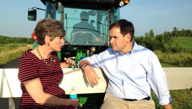 Iowa U.S. Sen. Joni Ernst chats with Florida U.S. Sen. Marco Rubio. Rubio has appeared at several Iowa functions Ernst has organized.