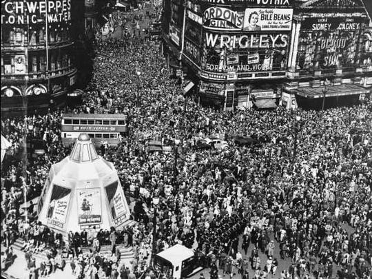 Crowds throng Piccadilly Circus in London on VE Day